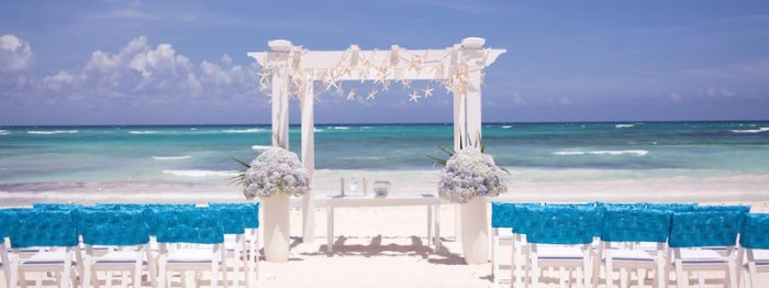 shutterstock_beach-wedding-ceremony-with-blue-water